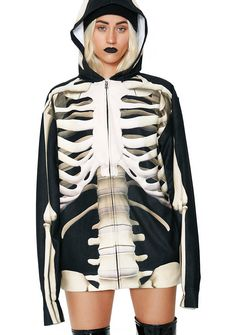 X-Ray Vision Skeleton Hoodie we can see right thru ya, BB! We are getting a boner with all that yer exposing in this sik sweater, featuring a supa detailed photo realistic print of a skeleton on the front and back.This BB has a front zip and attached hood that has prints of a skull on each side. Fitting relaxed on yer body with a lightweight feel fer the perfect drape, it's not hard to see that yer bad to the bone.