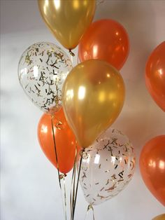 Up close rectangle confetti balloons with a mixture of Pearl gold and orange