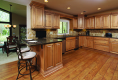 """Glazed Maple Cabinets with Granite Countertops and Distressed """"Hickory"""" Laminate"""