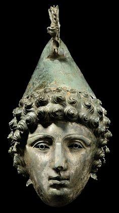 A ROMAN BRONZE CAVALRY PARADE HELMET   CIRCA LATE 1ST-2ND CENTURY A.D.