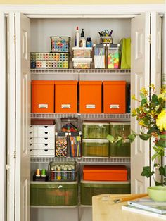 Love the punch of color and the ease of access to all the supplies in this closet!  And you can close the doors when you are done! :)