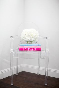 Clear Chair Books And Flowers