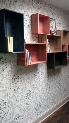 Saw this in a French bakery and plan to steal the awesome idea - wine (or fruit) crates repurposed as shelving! Pallet Crates, Milk Crates, Wooden Crates, Fruit Crates, Pallets, Crate Bookshelf, Bookshelves, Hanging Shelves, Creative Home