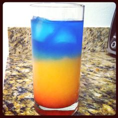 Skylight Pour 1 1/4oz vodka over ice, fill 2/3 of glass with orange juice, then slowly pour 1/2oz grenadine. In a separate glass, mix 1oz tequila and 1/2oz-1oz blue curaçao together. Slowly pour mixture in your glass. Ta-dah! Beautiful drink, tastes great too lol .....purdy