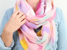 Upcycle a plain scarf with a little bit of paint to make this awesome DIY watercolor scarf for winter.