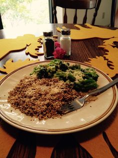 roasted quinoa with caramelized onions and broccoli