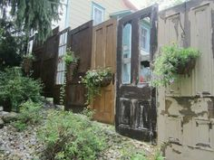 Love this - Privacy Fence made from old doors