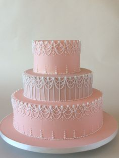 I just completed this new design. This soft peach and tan layered cake is caressed by drop stings with royal icing accents. Enjoy! Xoxo, Jq