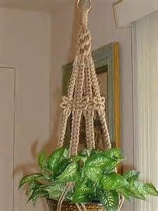 Jute macrame plant hanger  Trying to make one of these in HS art was how I learned I was allergic to jute.  Not a pretty sight.