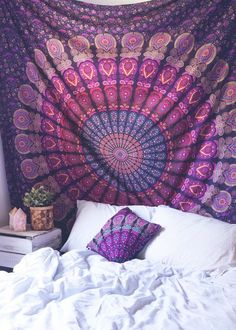 Top off your bed or accent a wall with this unique boho tapestry, featuring a colorful mesmerizing kaleidoscope-like mandala pattern. This tapestry also doubles