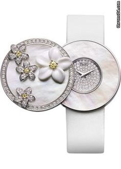 Piaget Limelight Paradise G0A34186 $37,680 #Piaget #watches #chronograph 18K white gold case set with 199 diamonds, four yellow sapphires and a white chalcedony flower