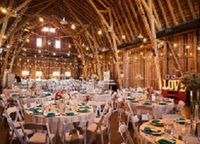 The Windmill Winery's two venues offer distinctly different and unique elements: the Big Barn or the new Lake House! The Big Barn can accommodate: 50 to 250 guests. Packages include a romantic wedding site, a horse-drawn carriage and most reception services. The Lake House is a unique venue that holds to The Windmill's authentic rural atmosphere, but with a nod to classic Hampton's style. The Lake House will feature a ceremony on the dock overlooking the breathtaking Superstition Mountains.