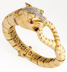 David WEBB, diamond, enamel, ruby gold bracelet  The bracelet features a diamond and enamel tiger applied on 18k gold