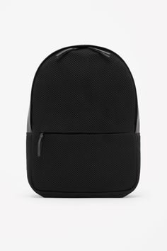 Sportswear-inspired, this modern backpack has a tactile mesh body and smooth leather details. Designed for practicality, it has adjustable leather straps, front zip pocket and a padded interior with secure laptop sleeve.