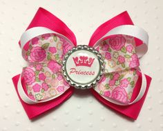 Pink Floral Princess Hair Bow with Bottle Cap Center via Etsy