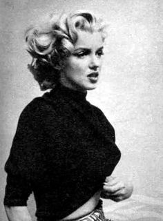 Marilyn Monroe.  i've always loved her.  she is magnificently beautiful and was a really courageous and unique soul.  a rebel at heart and very articulate.  brains and beauty.