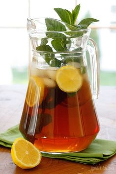 What can be more thirst quenching on a hot summer day than a tall glass of fresh brewed iced tea over ice with lemon and fresh mint leaves...  Spearmint is always the first thing to bloom in my garden every spring. As it sprouts each Spring, it always brings back memories of my childhood as Mom would always put fresh mint in our iced tea. Funny how smells can take you back in time, I just can't walk past my mint without pleasant thoughts of iced tea.  Making home brewed tea is very simple…