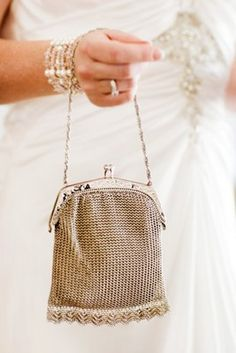 A vintage silver purse for the bride (Photo by Calli B Photography)