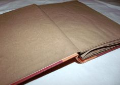 recycled book turned personal/scrapbook using paper bags from the grocery store