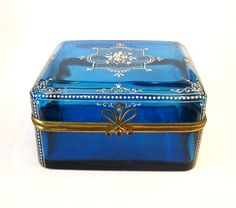 Antique vintage 19th Century French glass casket box in turquoise with white enameling design and bow clasp.