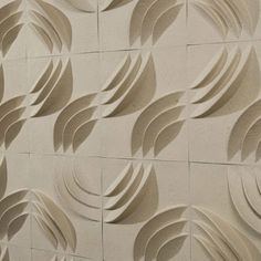 Ripple Wall PaperForm wall tiles (Set of 12) -- Create a captivating focal point or redo your living room with the eye-catching Ripple Wall PaperForm Set, highlighting a chic geometric design with a warm natural finish.    Product: 12 Wall tiles Construction Material: 100% Post and pre-consumer waste paper Color: Natural Features: Paintable surface so you can customize your look Install temporarily with double stick tape, or permanently with wallpaper paste.