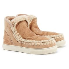 Mou Eskimo Tan Embroidery Shearling Sneakers (£112) ❤ liked on Polyvore featuring shoes, sneakers, tan, round toe sneakers, shearling shoes, round toe shoes, slip-on sneakers and tan shoes
