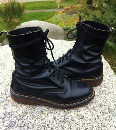 Soooo tempting :) Vintage 80s 90s Doc Marten Tall Black Leather Grunge Boots 10 Eye Made in England UK Size 5 Goth Glam Punk Combat. $65.00, via Etsy.
