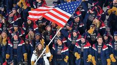 USA's flagbearer Erin Hamlin leads her delegation as they parade during the opening ceremony of the Pyeongchang 2018 Winter Olympic Games at the #Pyeongchang Stadium on February 9, 2018. #TeamUSA