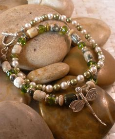 I have paired a luscious strand of Ocean Jasper gemstones with delicate Swarovski crystal pearls in light green and white. For added design and