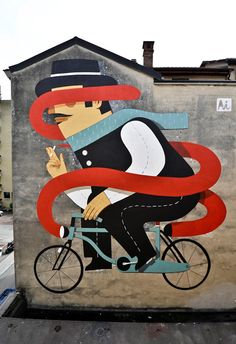 Rome-based multidisciplinary artist, Agostino Lacurci, recently finished this vibrantly colored cigarette-smoking bicyclist on the exterior of a large building in Lugano, Switzerland. To see more of Lacurci's work check out his website.