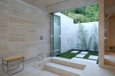 12 Outdoor Showers: This fabulous home in Los Angeles, designed by Tocha Project, has a screening room, meditation room, wine room, and a pretty fantastic indoor/outdoor bathroom.