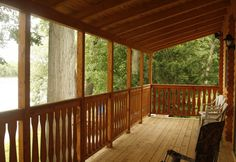 log home Porch to river