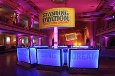 "Glowing bars bearing the ""Dance Sing Dream"" motto anchored the after-party space in Philadelphia."
