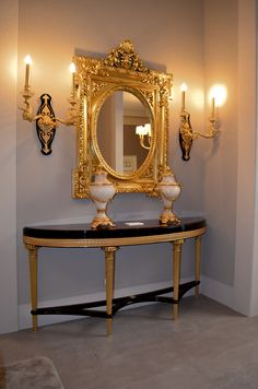 Console table from Le Marais collection. Rich walnut burl wood and outstanding gold leaf hand carved wood legs, are the main elements of this master piece. Alabaster vases with bronze ornaments, bronze gilt empire style wall sconces and superb hand carved gilt mirror, complement this luxury setting. Walnut Burl, Walnut Veneer, Sideboard Furniture, Hand Carved, Carved Wood, Empire Style, Luxury Furniture, Marines, Wall Sconces