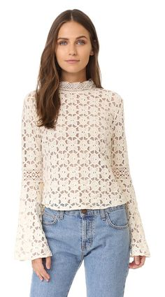 On SALE at 70% OFF! kiss & bell lace top by Free People. A delicate lace Free People blouse with a victorian inspired look. The long bell sleeves create a dramatic profile. B...
