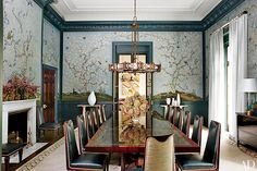 """""""Peacock blue has a luminous depth about it that nature does so well—the feathers of a peacock seem to shimmer and glow. I find peacock lacquer or high-gloss paint the most seductive way to create a striking, enveloping space that coddles and inspires.""""  A Gracie wallpaper enlivens the dining room of a Long Island, New York, house decorated by Steven Gambrel."""
