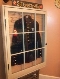 A marine corps uniform display case made from an old barn window!
