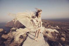 Windy wedding goddess in Santorini