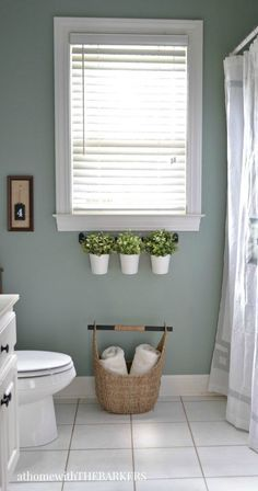 In this bathroom renovation project, Sonya of completely transforms an outdated bathroom to a relaxing and modern space with a fresh coat of Green Trellis. She replaces old decor with earthy plants along the window sill and a soft white shower curtain. Rideaux Design, Simple Bathroom, Bathroom Ideas, Warm Bathroom, Small Bathroom Window, Master Bathrooms, Mint Bathroom, Bathroom Blinds, Bathroom Color Schemes