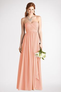Multi directional pleats add texture to  the  sweetheart  bodice  of  this pretty peach fuzz chiffon gown