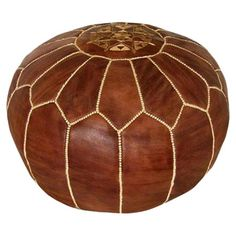 Handmade leather pouf with a medallion design.   Product: PoufConstruction Material: Genuine leather and shredded foam...