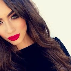 Modern glamour look. Red lipstick, red blush, white eyeshadow inner corners, big eyelashes and well groomed eyebrows.
