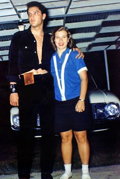 Elvis with a happy fan at Graceland, 1960 (probably July 19, 1960). Check out Elvis's leather wrist band with his initials and the early 1960's Ford Falcon in the background . No, it's not toast but his wallet stuck to his trousers. ;-)