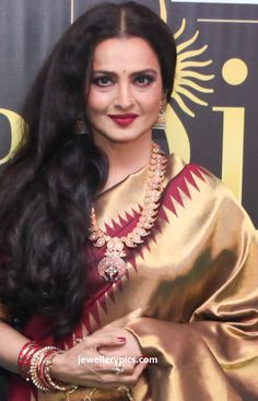 Rekha- timeless Indian beauty ... she must be over 60 in this pic... wearing traditional south Indian jewelry