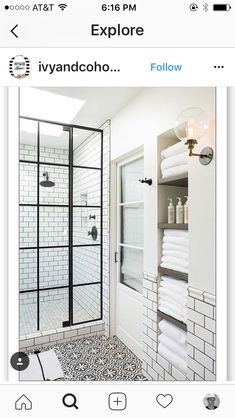 White and black bathroom boasts an alcove filled with shelves holding towels alongside a white and black floor in Cement Tile Shop Bordeaux Tiles. More I like this set up and design! Bathroom Renos, White Bathroom, Small Bathroom, Bathroom Storage, Washroom, Master Bathroom, Black Bathrooms, 1930s Bathroom, Modern Bathroom