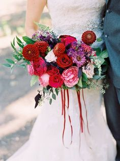 Bright & Beautiful Avalon Legacy Ranch Wedding. Vintage from Rent My Dust.  Photos by Jessica Gold Photography.  Gorgeous bridal bouquet in red, purple, rust, pink and peach from Rlove Floral