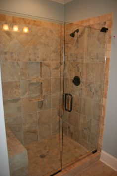 Tile shower with seamless glass door and bench seat