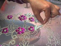 How to make sequins beaded flower applique motif Handmade craft In this video the artist is using a latch hook tambour needle which allows her to see her product as she works.