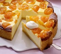Apricot Cheesecake. Recipe in German. Butter crust. Filling: apricots, cream cheese, custard powder, apricot jam, powdered sugar, apricots.