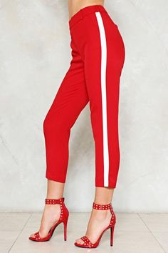 Sun side dance step for two. The Two Steps Twice Pants feature a high-waisted silhouette, elasticized back waistband, pockets and contrast stripe detailing at sides, and decorative pockets at back. Striped Pants, Nasty Gal, Joggers, Two By Two, Contrast, Capri Pants, Casual Outfits, Silhouette, Boots
